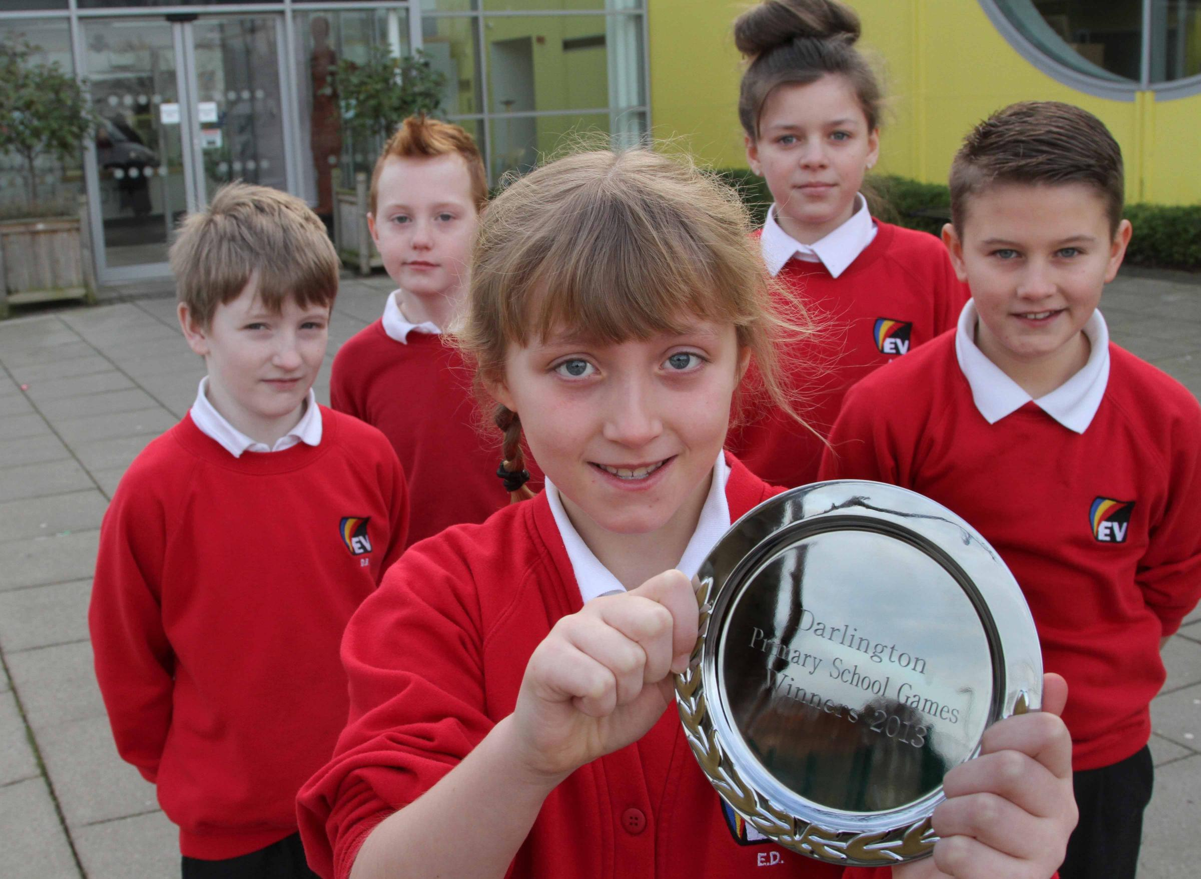 Young athletes from Springfield Academy who won the Darlington Primary School Games with their trophy from left David Beattie, 10, James Taylor, 11, Emma Doudican, 9, Arizona Rutter, 11 and Taylor Hutchinson, 10. Pic: Andy Lamb