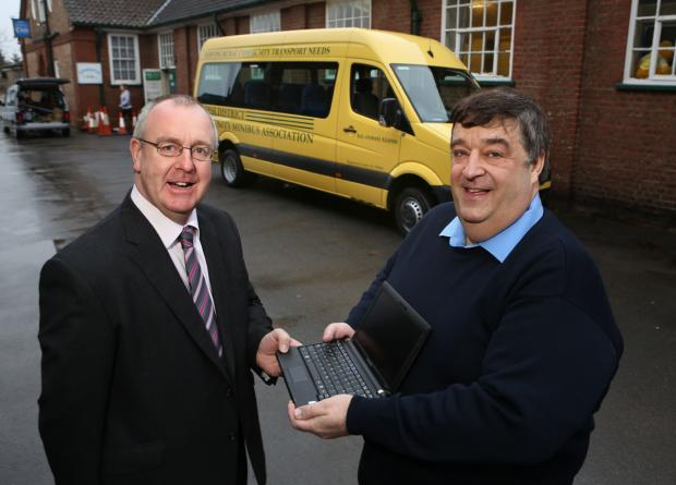 Councillor Mark Robson with Dave Elders, secretary of Thirsk District Community Minibus Association.