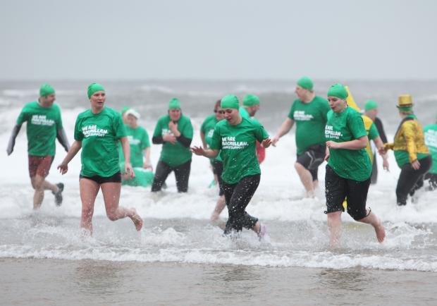 Darlington and Stockton Times: Energy company workers brave freezing sea to raise cash for charity