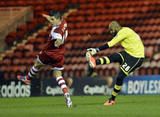 ON THE CHARGE: Middlesbrough's Emmanuel Ledesma charges down a clearance by Wigan Athletic goalkeeper Al Habsi