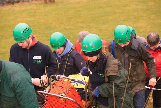 The Dales Rural Trainees carry YDMT's Jo Boulter on a stretcher to safety in a mountain rescue scenario. Photo: Steve Finch.
