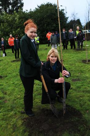 Sedgefield Community College pupil Emma Churlish and teacher Joanne Maher help Sedgefield in Bloom plant an apple orchard.