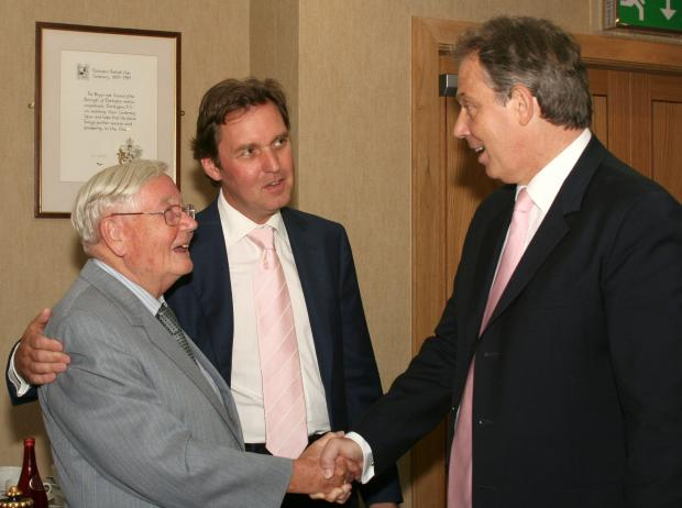 FLASH BACK: Cliff Hutchinson left, shakes hands with then-Prime Minister Tony Blair in 2005. Also pictured is the town's then-MP, Alan Milburn