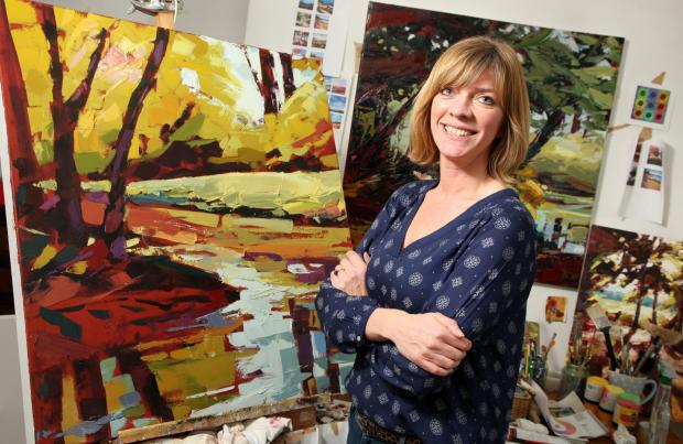 Angela Edwards with some of her paintings