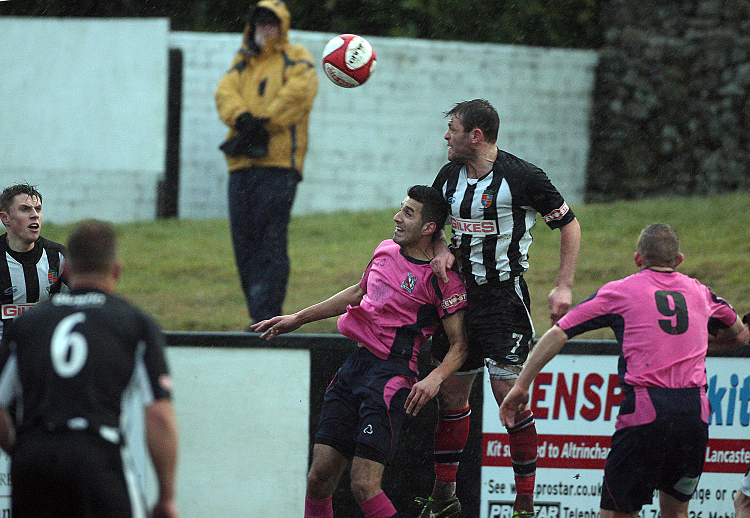 HIGH CHALLENGE: Amar Purewal jumps for the ball with Kendal Town's Ricky Mercer