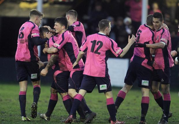 ALL SMILES: Stephen Thompson, second left, is congratulated by his team-mates after scoring against Kendal