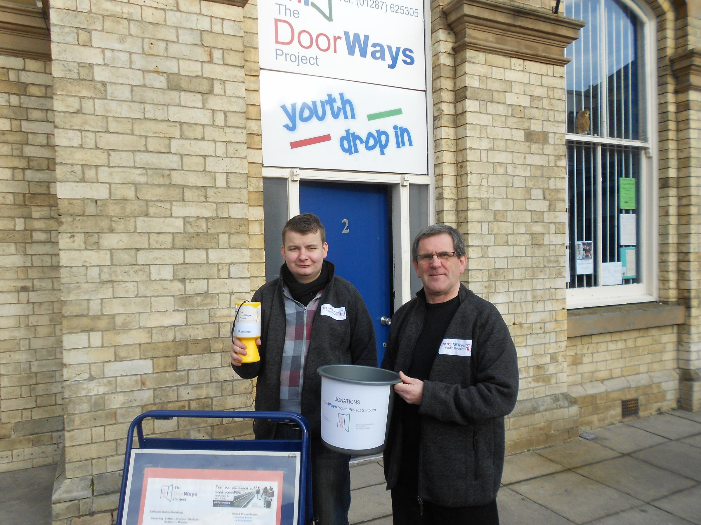 John Thompson and John Pearson collect money for the DoorWays project