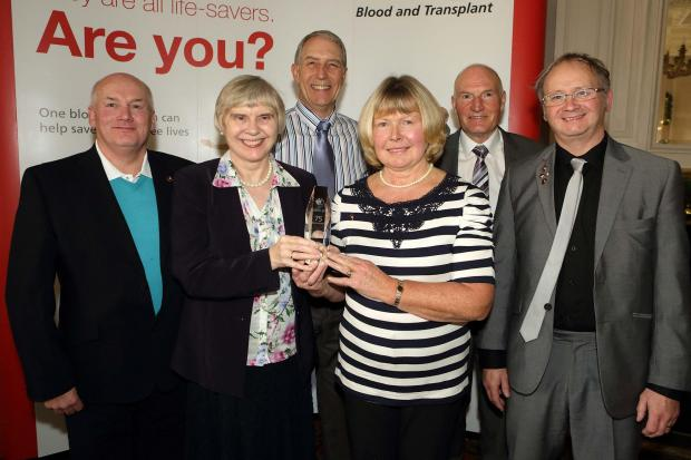 Receiving crystal awards for reaching their 75th blood donation, from left to right: Steven Hunter, Ruth Hawken, Eric Wilson, June Kneller, Brian Lyall, and Peter Sowerby.