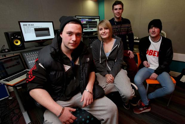 Freestyle rapper Adam Skidmore (left) during recording at Myplace Youth Centre in Middlesbrough with fellow vocalist and producer Jenny Dixon, and Ethan Covell (vocalist, right) and producer Will Simpson (ba