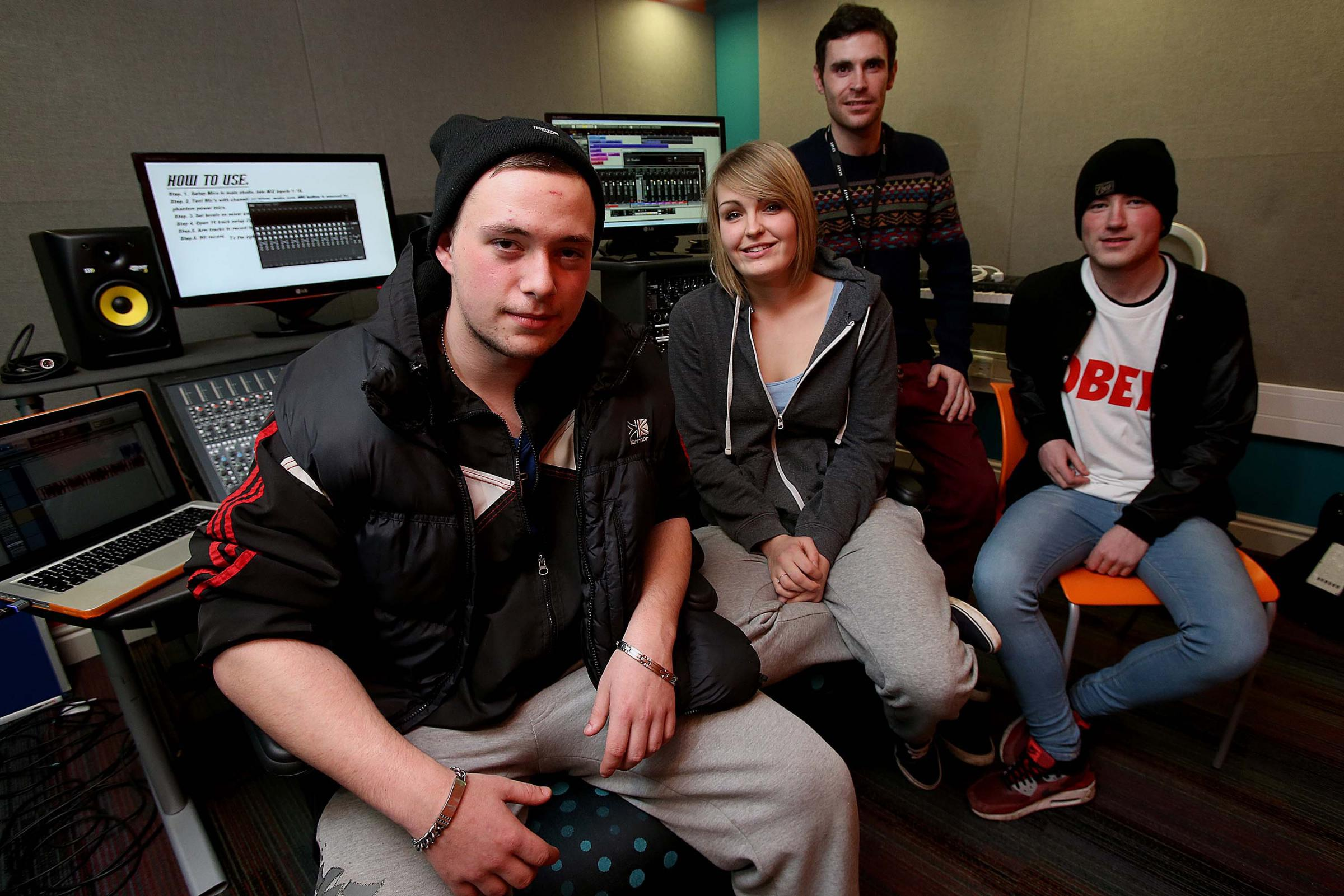 Freestyle rapper Adam Skidmore (left) during recording at Myplace Youth Centre in Middlesbrough with fellow vocalist and producer Jenny Dixon, and Ethan Covell (vocalist, righ
