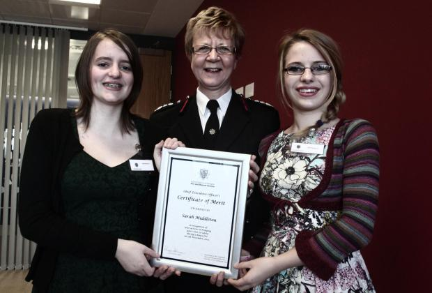 Emily Middleton with fire chief Susan Johnson and Sarah Middleton.