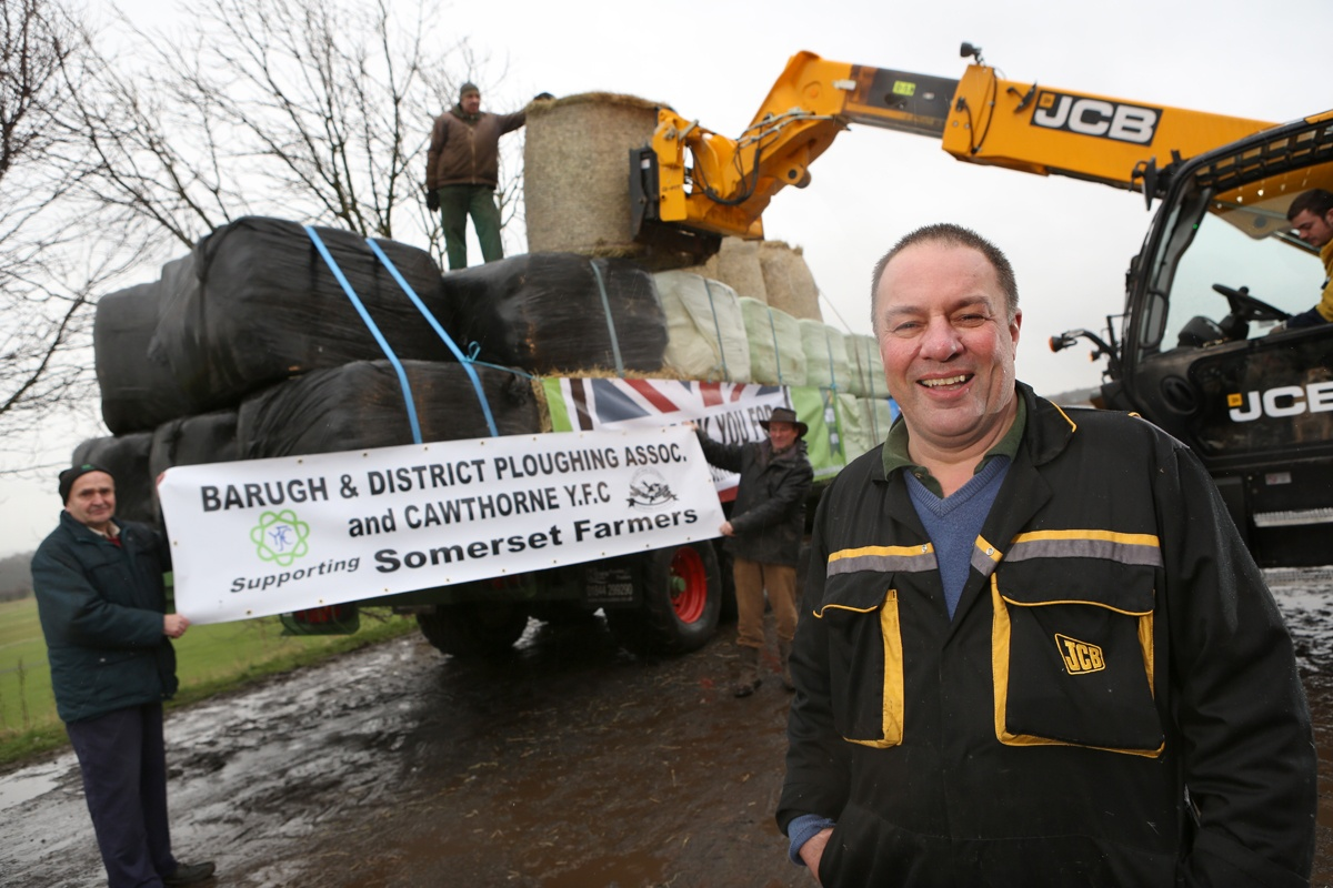 ON THE ROAD: Philip Rowbottom, front, gets ready for his long tractor drive to Somerset