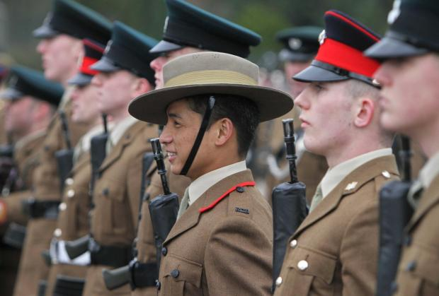 Gurkha soldier Khop Jung Gurung on the passing out parade at Catterick Garrison with a British platoon