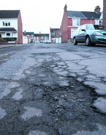 Pesky potholes - a menace for drivers
