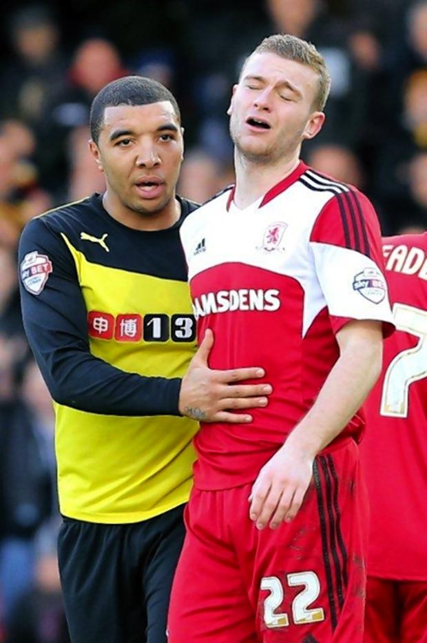 Darlington and Stockton Times: Watford striker Troy Deeney with Middlesbrough's Ben Gibson, who had just been sent off. Picture: Dave Peters.