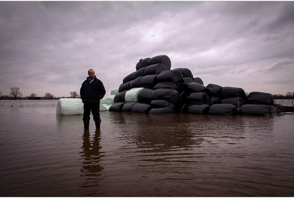CHEERS: James Winslade has lost thousands of bales of hay and straw to the floods in Somerset