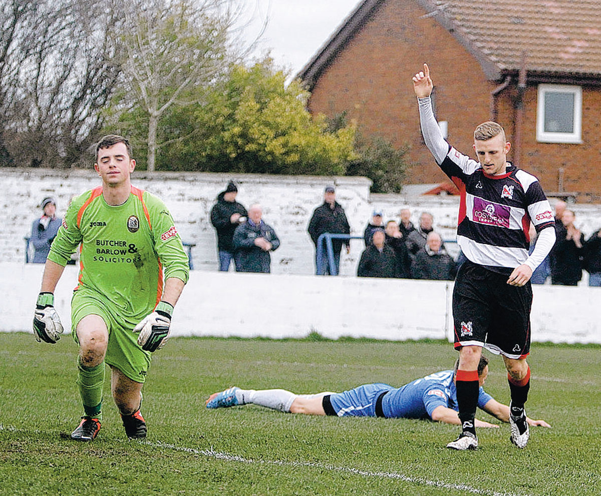 ONE GOAL UP: Radcliffe Borough goalkeeper Chris Cheetham climbs back to his feet as David Dowson celebrates making it 1-0 to Darlington