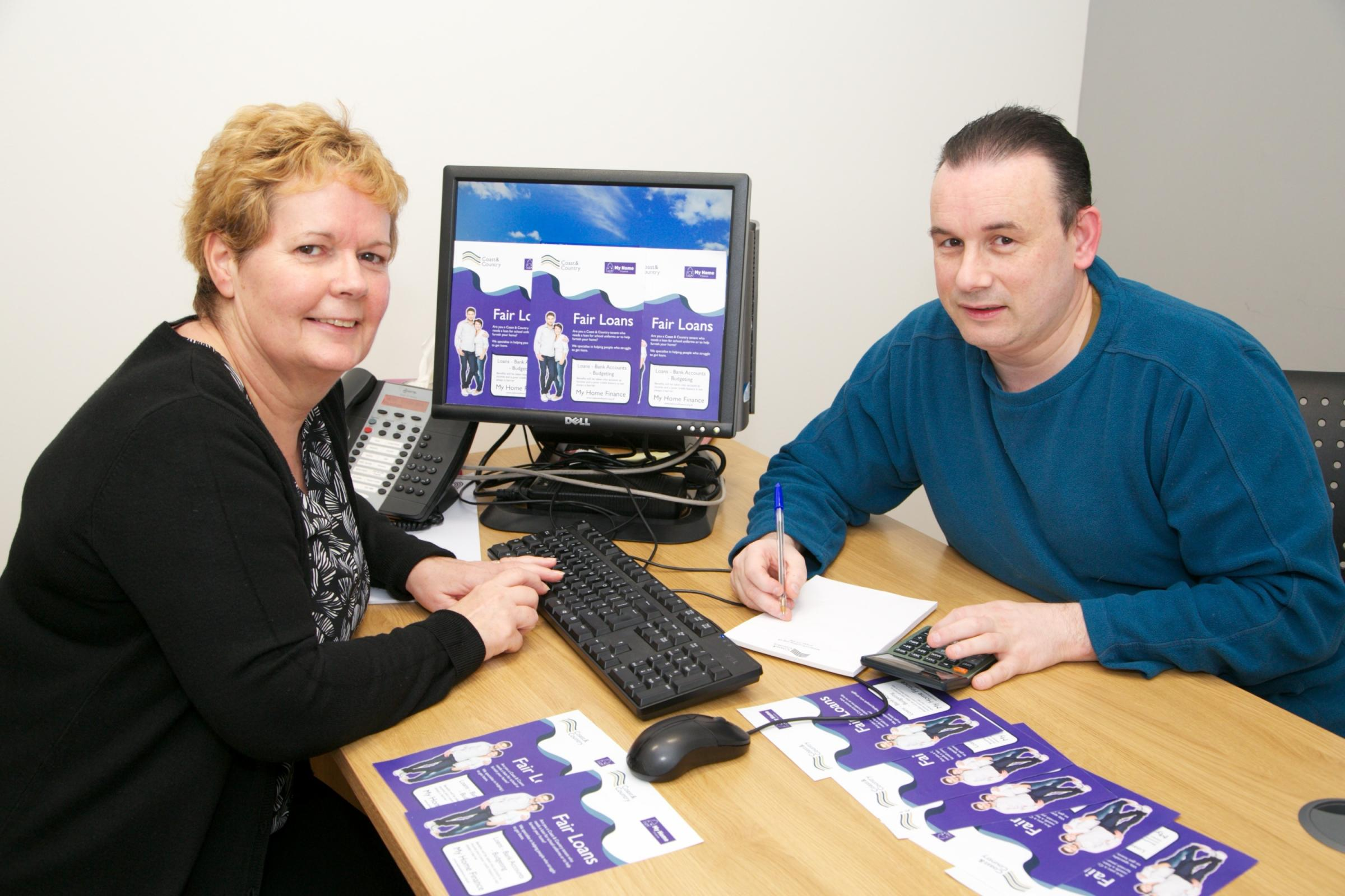 Loan officer Janice Dawson with Coast & Country tenant Paul Wilson