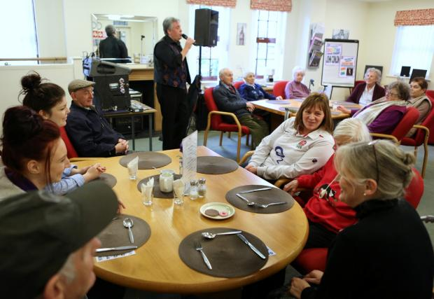 Singer John Conlon entertains centre users and staff