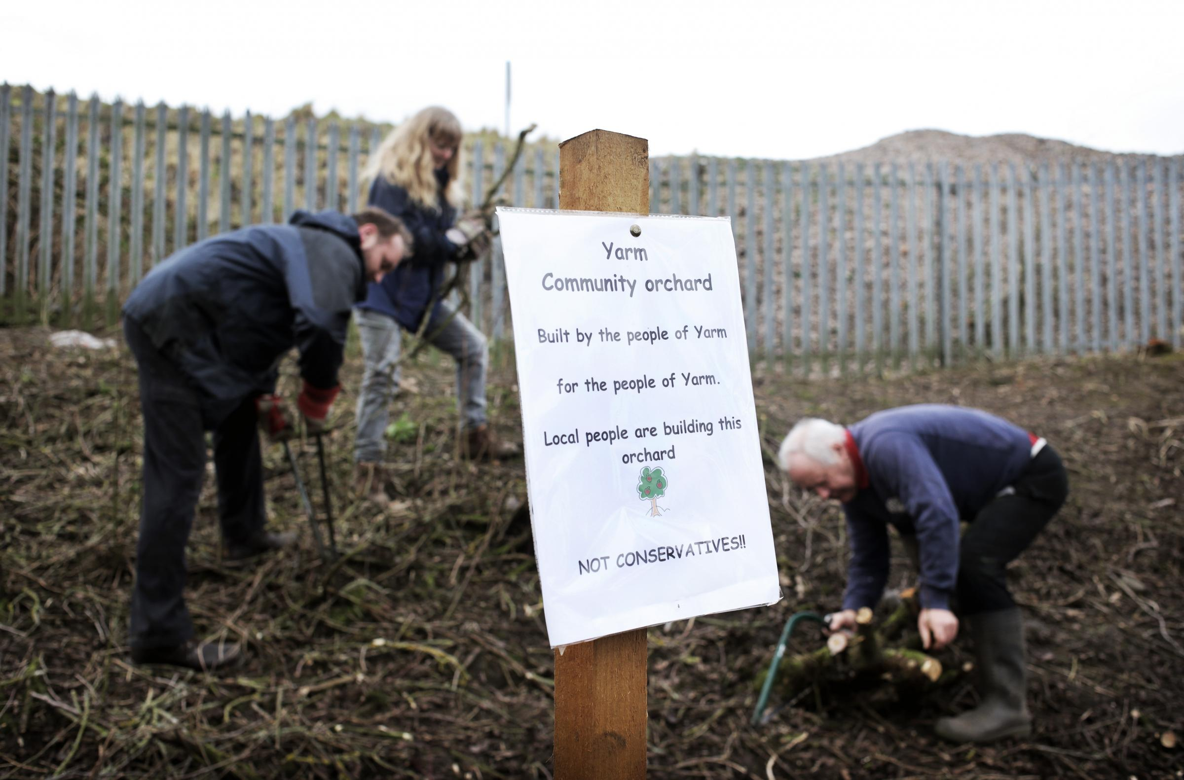 From left, Mark Chatburn, Carole Jones and Bob Wegg at work on Snaiths Field in Yarm. They say that local Conservatives are wrongly claiming the community orchard as their initiative.