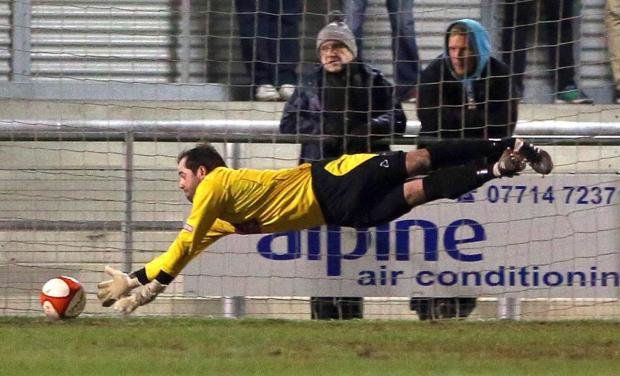 Darlington and Stockton Times: BELLY FLOP: Darlington goalkeeper Mark Bell dives full-stretch but cannot keep Tom Kilfin's shot out