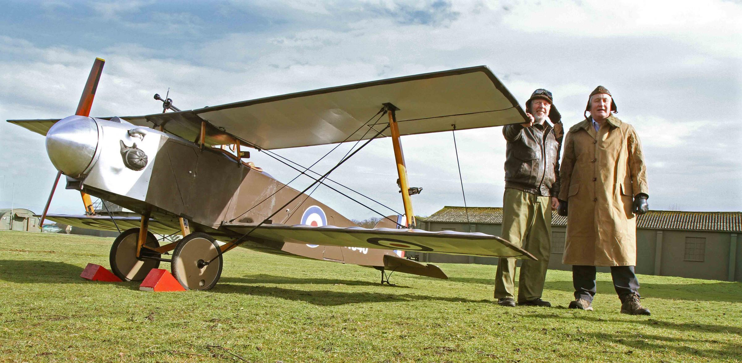 The Eastchurch Kitten World War I fighter plane is started up by volunteers Brian Watmough and Grant Sparks at the Yorkshire Air Museum.