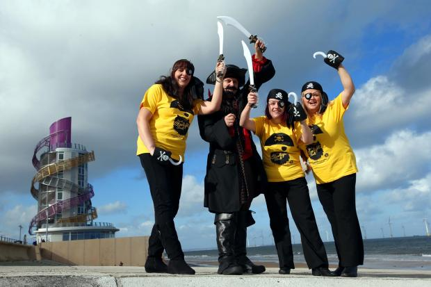 Darlington and Stockton Times: Official launch of Teesside Hospice's Seaside Starlight Stroll 2014 on Redcar seafront which has a pirate theme.  Pictured (L-R) are Kim Bradley,Michael Freeman, Leanne