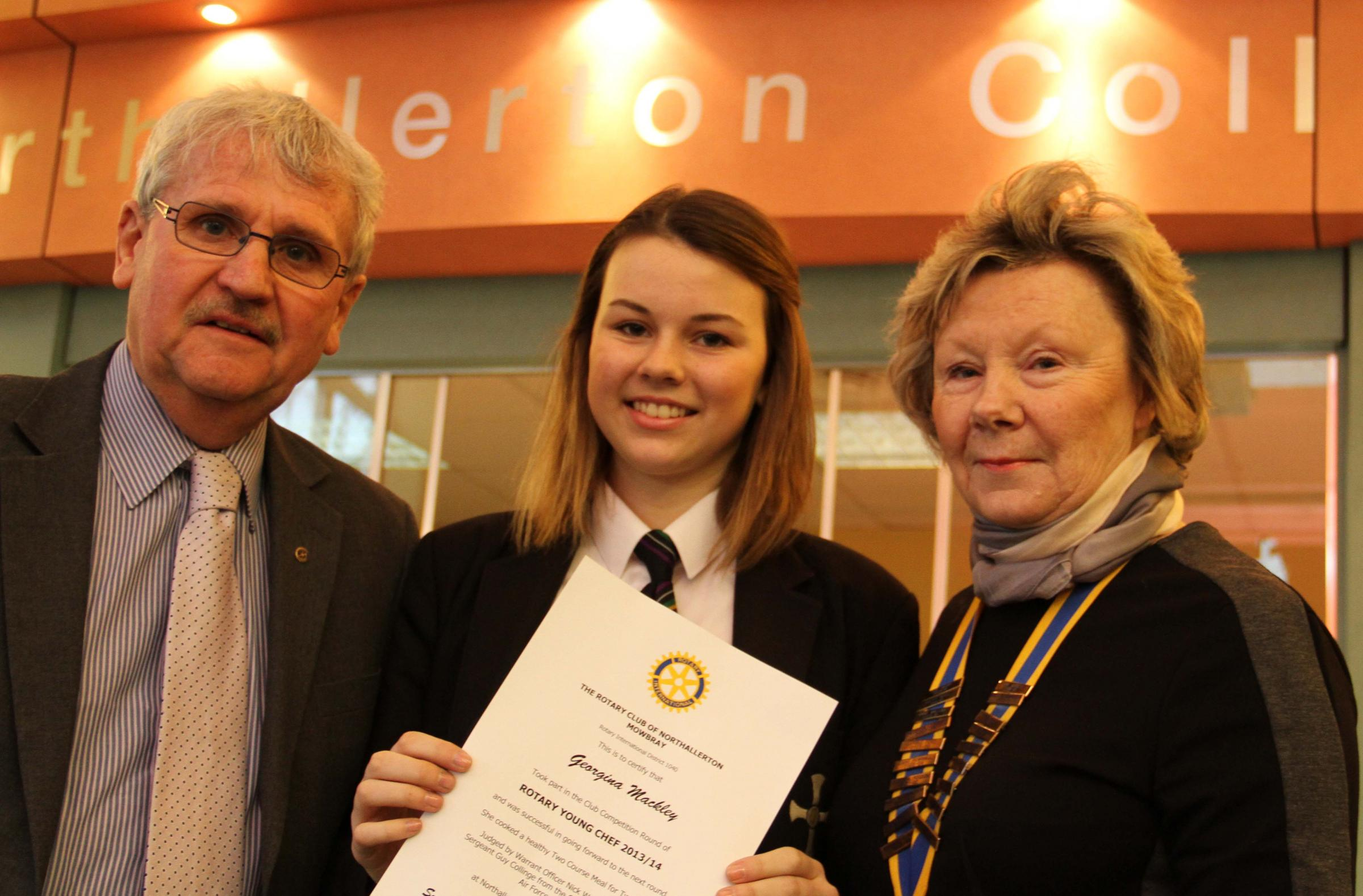 Northallerton College student Georgina Mackley is presented with a Rotary Club award for her efforts by governor Kevin Hardisty and Northallerton and Mowbray pres