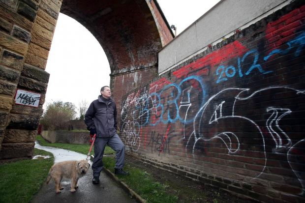 Yarm councillor Andrew Sherris by the graffiti