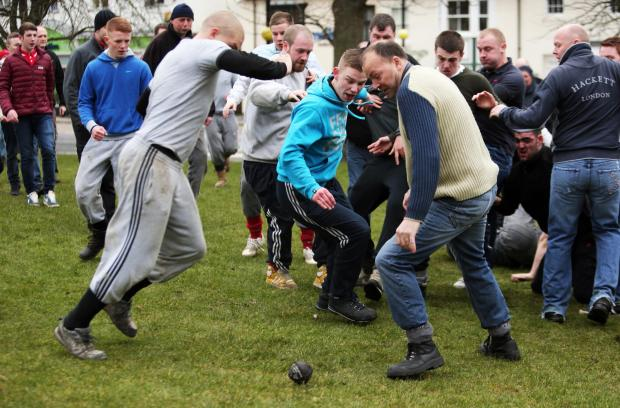Competitors battle for possession of the ball at the Shrove Tuesday Ball Game in Sedgefield last year