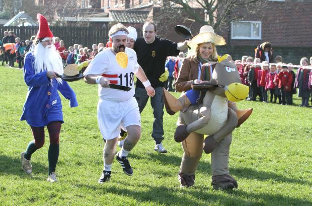 Competitors in the fancy dress section of Northallerton's annual Shrove Tuesday pancake races.