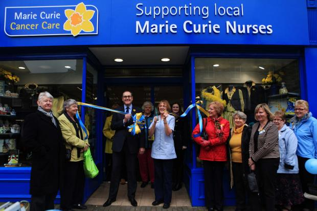 READY TO GO: Marie Curie nurse Dawn Dyne opens the charity's shop in Barnard Castle with, left, Alec Barclay, head of shops