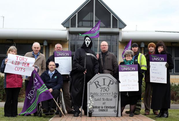 Grim Reaper leads protest over job cuts at Redcar and Cleveland Council.