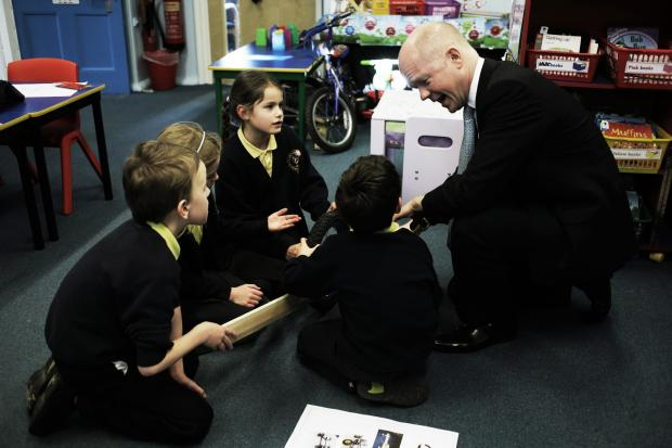FLOOR DEBATE: Foreign Secretary William Hague talks to Matthew Partridge, William Greer, Hollie Wilkinson and Emily Bowler-Jones at Eppleby Forcett CE Primary School