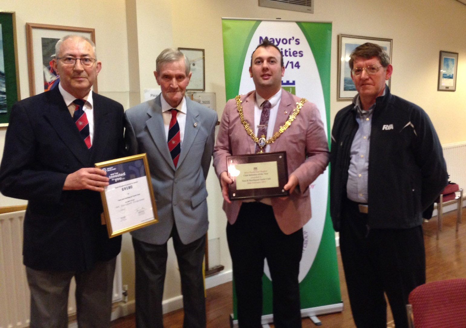 Photo caption: Councillor Stephen Akers-Belcher (third left) presents awards to Barry Hughes (left) and Tommy Richardson (second left)