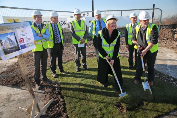 The first turf is cut by Ruth Thompson of Homes and Community Agency and Darlington Borough Council leader Bill Dixon at the site of Darlington's Business Growth Hub.