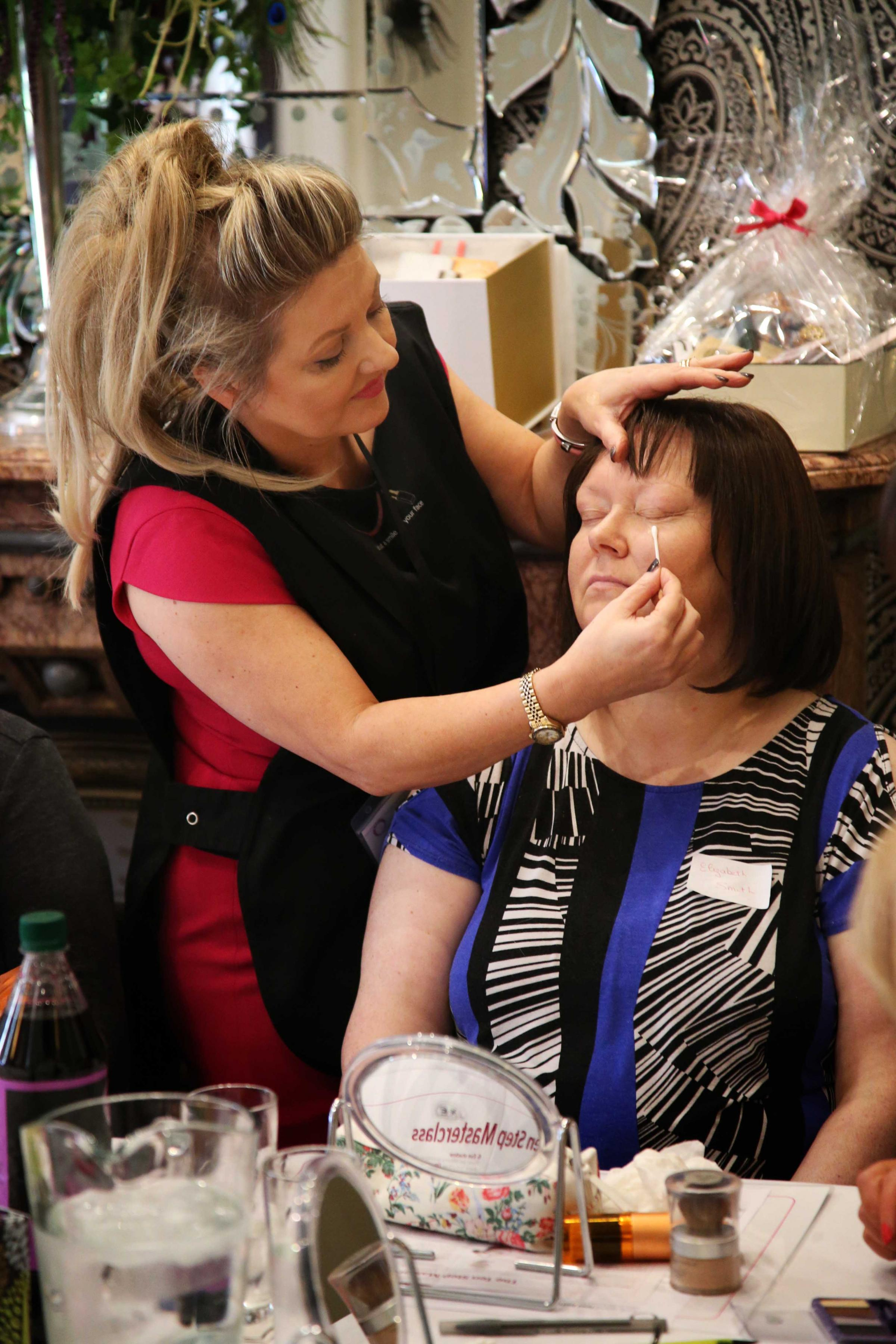 Andrea Mackrell, left, gives beauty treatment to Elizabeth Smith at the Look Good Feel Better masterclass at Bannatyne's Hotel