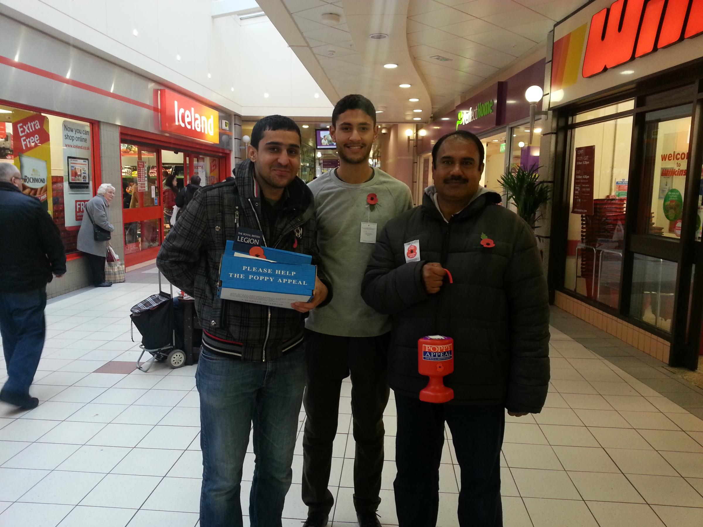 CHARITY WORK: Right to left, Zaheer Ahmad, Syed Adil Ahmad and Moaz Ahmad, from Ahmadiyya Muslim Youth Association, collecting for the Popp Appeal at the Castlegate Shopping Centre, in Stockton.
