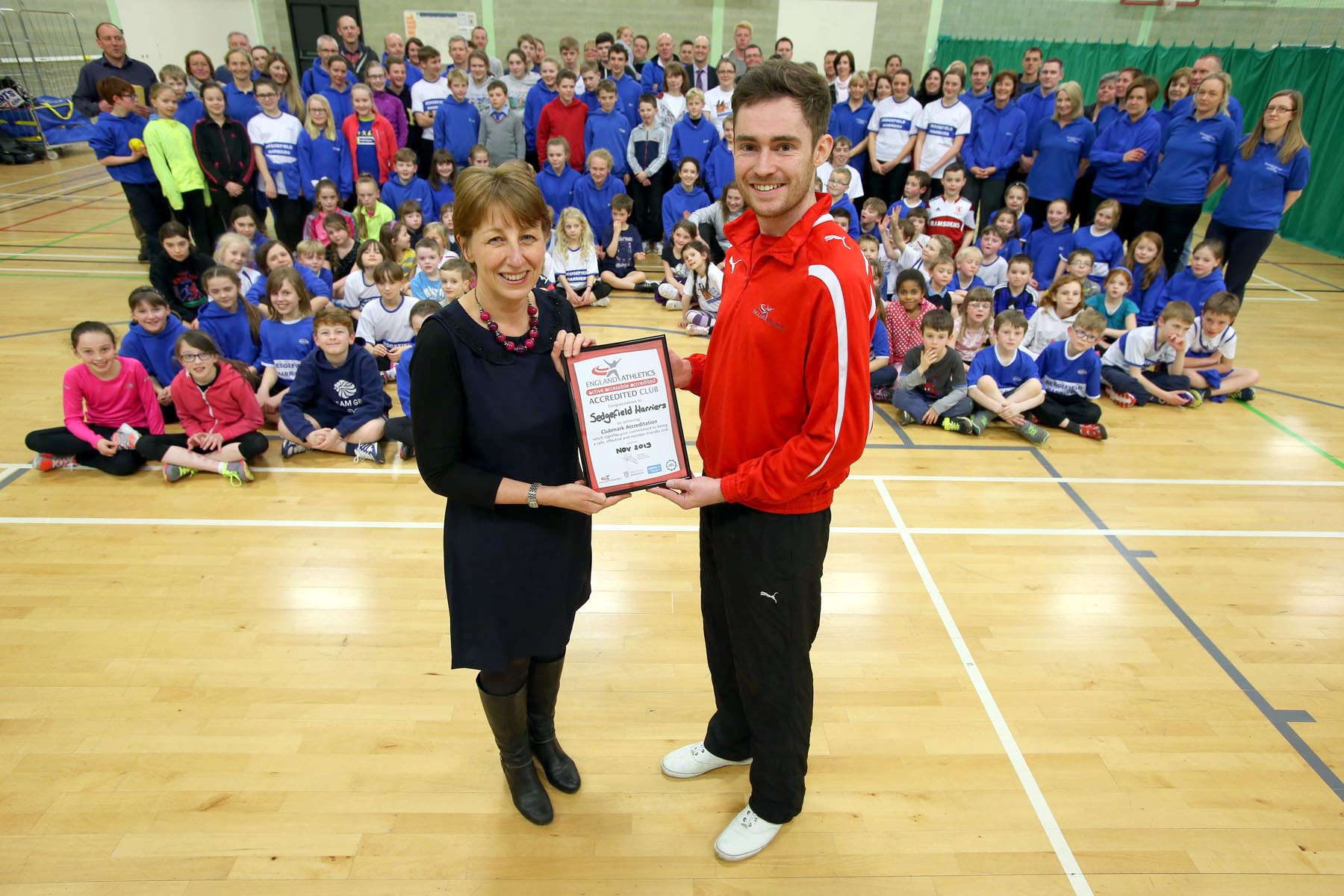 OFFICIAL RECOGNITION: Helen Letts, Sedgefield Harriers Club Mark co-ordinator, and John Stacey, club and coach s