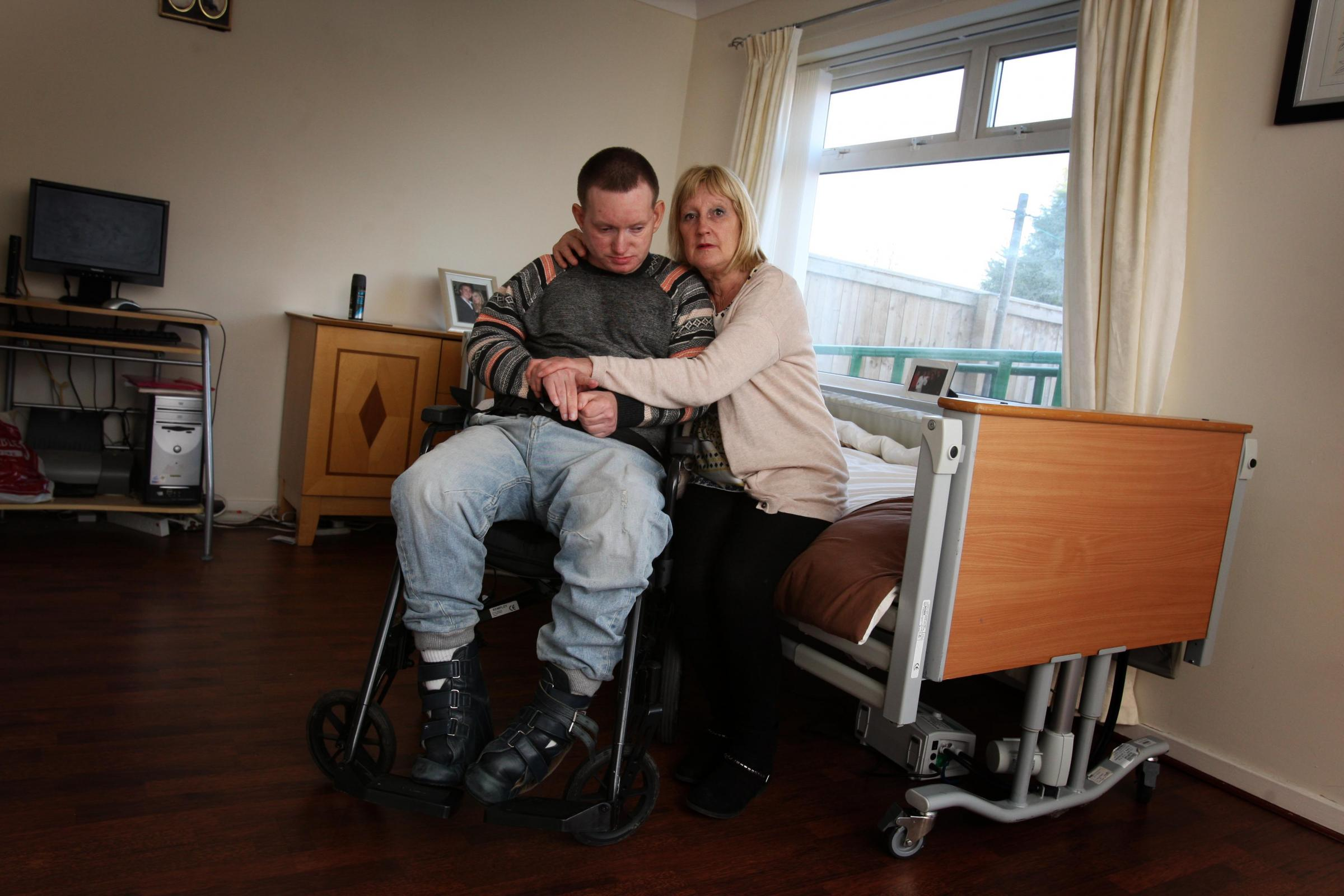 Marilyn Barker who looks after Peter Barker, her 35-year-old, severely disabled, incontinent son, has been ordered to have a stairlift removed from their home meaning she has to take him 1.5miles away just to get a shower. Picture