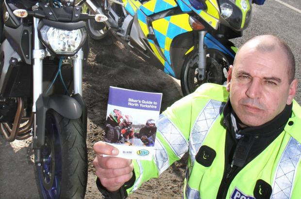 SAFETY WARNING: Sergeant Sean Grey, of North Yorkshire Police Motorcycle Unit, with the Bikers' Guide to North Yorkshire at the launch of the safety campaign with Darlington motorcyclist Dave Coates