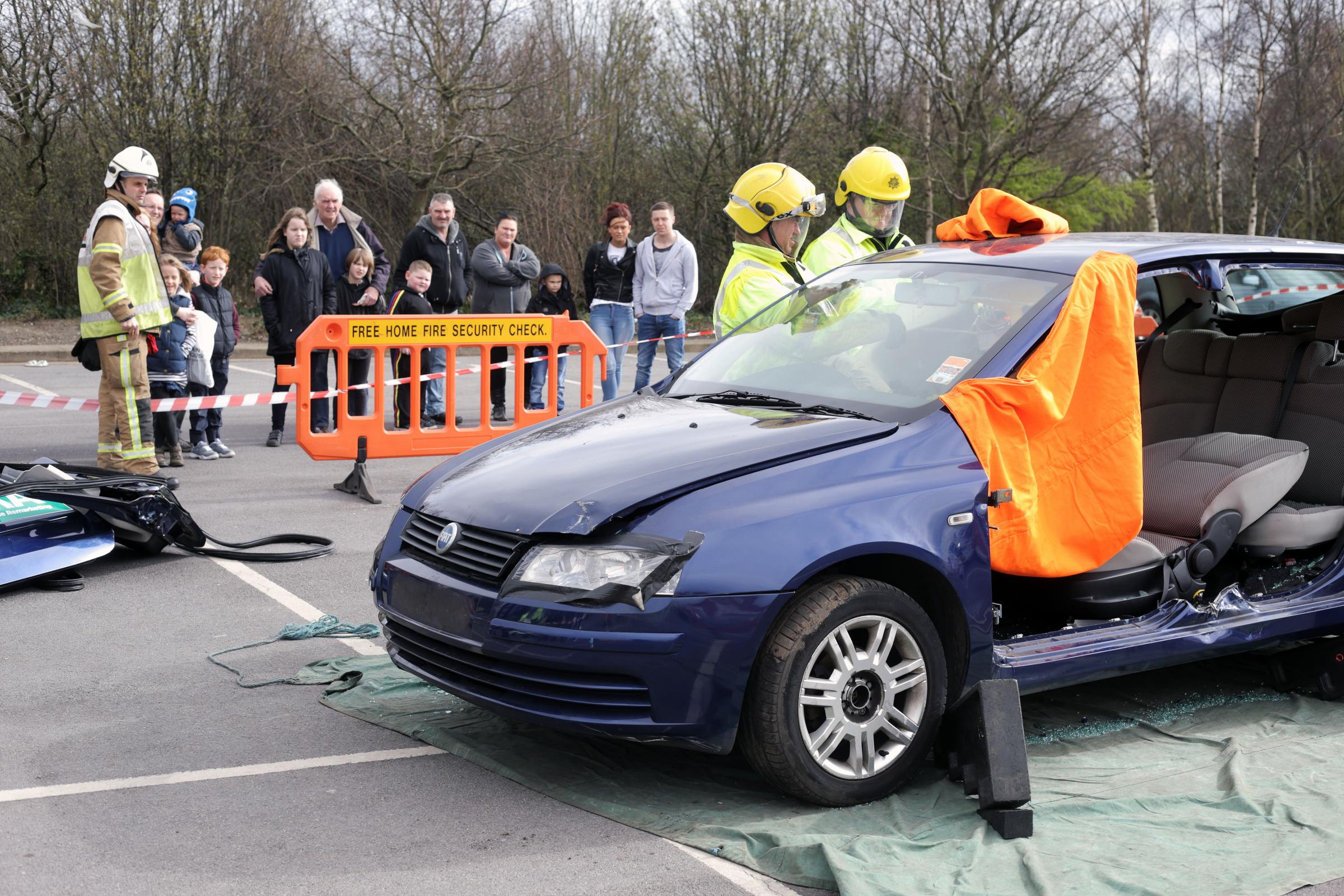 Fire fighters demonstrate rescue techniques during a road safety roadshow in Darlington