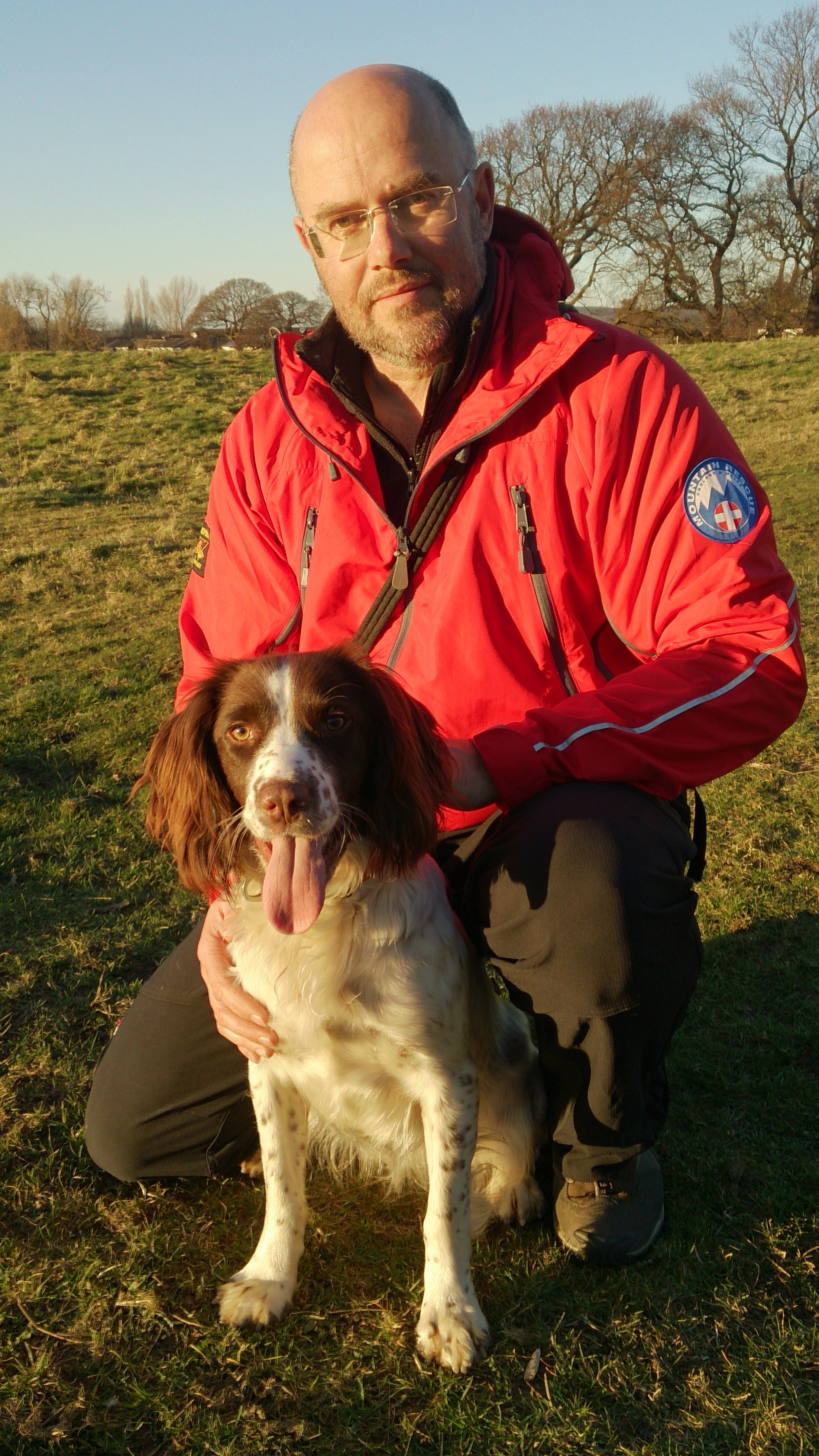 Trainee rescue dog Poppy with her owner and handler Richard Oldham.