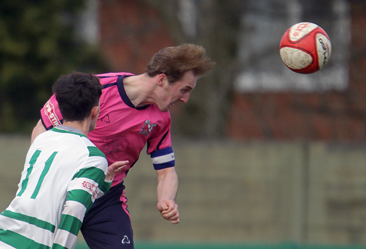 HEAD FIRST: Quakers captain Gary Brown heads the ball away during Saturday's 1-1 draw at Northwich Victoria