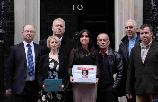 Yvonne McHugh (centre), the girlfriend of Billy Irving, is joined by family members of other prisoners including Lisa Dunn (second left), as they deliver a petition to 10 Downing Street