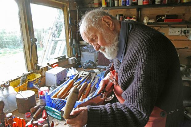 Mark Henshaw at work in his shed.