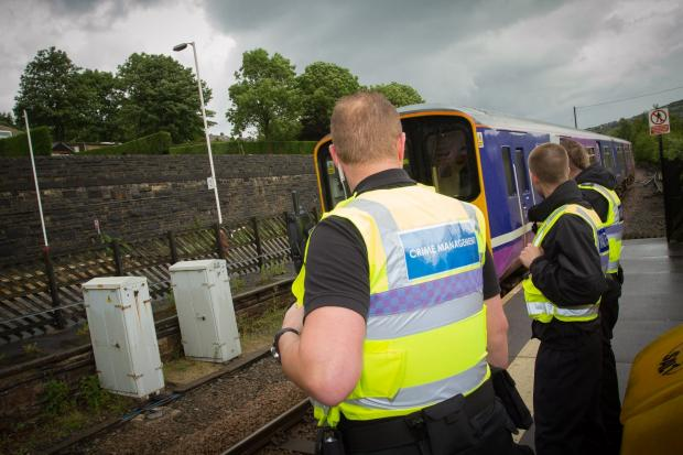 Northern's specialist response team, which tackles anti-social behaviour, awaits the arrival of one of its trains