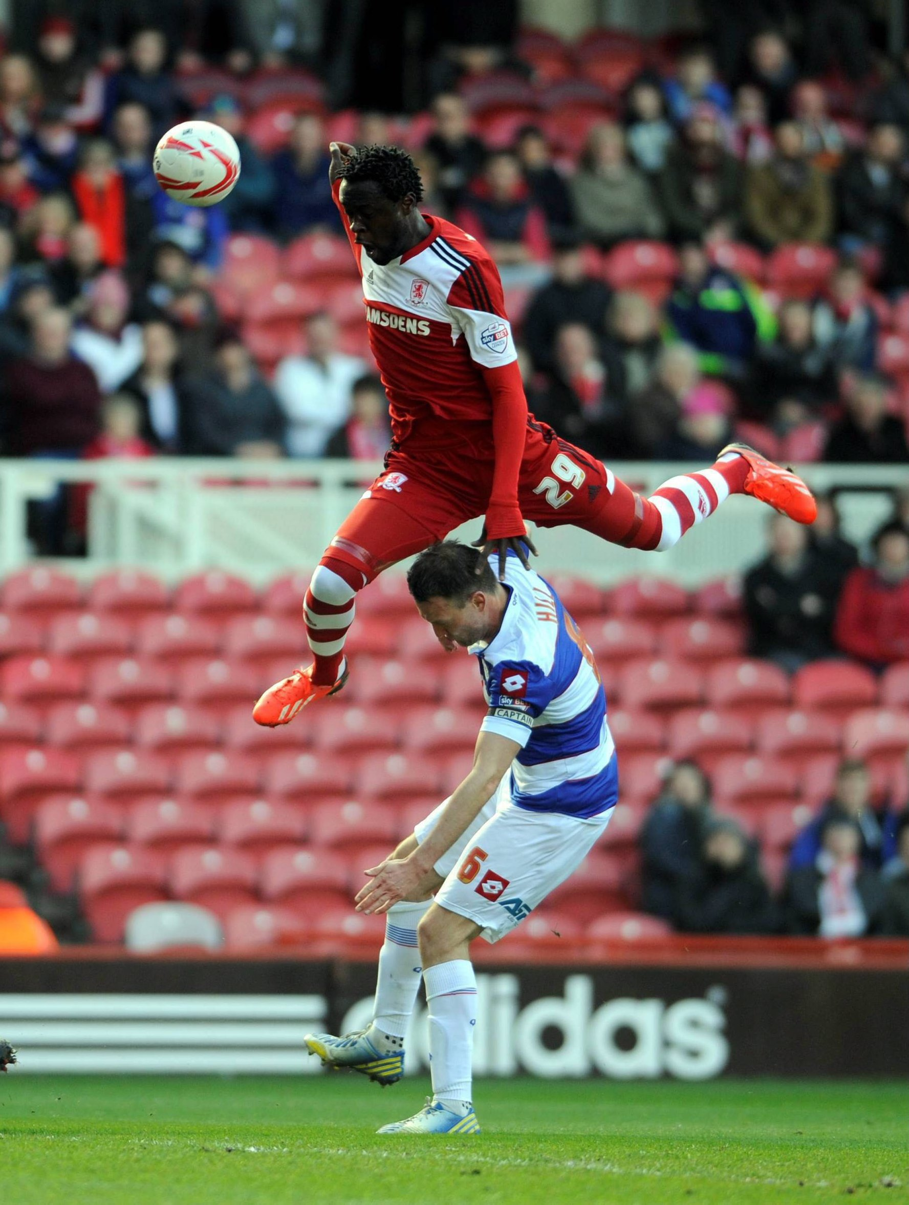 AIR PLAY: Middlesbrough's Kei Kamara leaps over QPR's Clint Hill during the Londoners' 3-1 win on Saturday at the Riverside Stadium