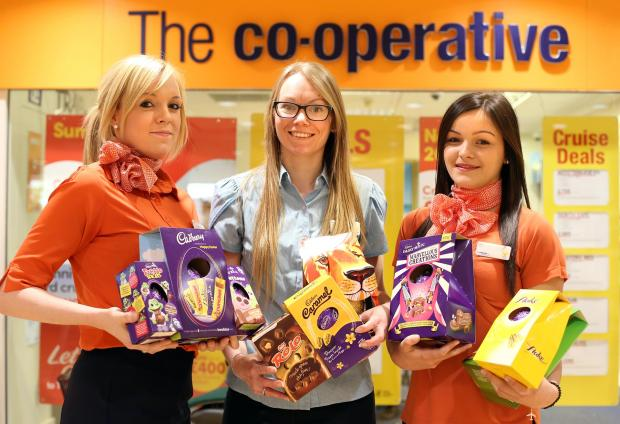 PUTTING A SMILE ON FACES: Co-operative Travel in Morrisons, in North Road, Darlington, launches the Easter egg collection along with Thomas Cook travel agents, from left, Amy Walker, from Co-operative Travels, Vicci Main, assistant manager at Thomas Cook