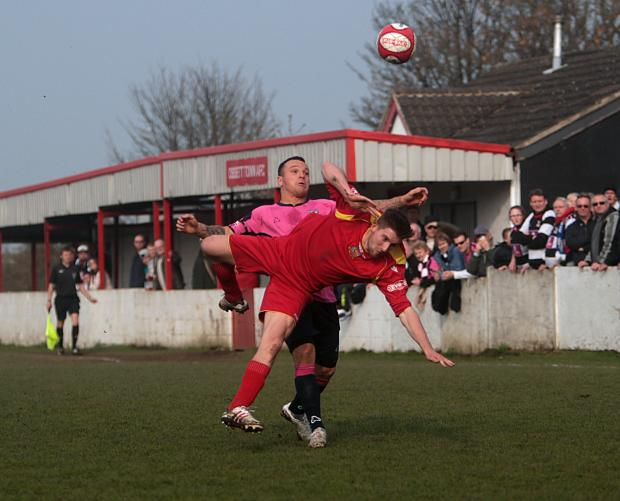 Darlington and Stockton Times: FALLING DOWN: Quakers' Stephen Thompson tangles with an Ossett Town opponent